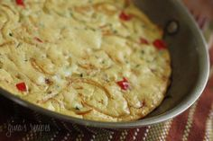 Caramelized Onion, Red Pepper and Zucchini Frittata  Frittatas are very versatile, they can be eaten for breakfast, lunch or dinner paired with a salad. Cut into small squares, they can be served as an appetizer as well. This is a simple, low fat combination of caramelized onions, peppers and zucchini.  Gina's Weight Watcher Recipes  Servings: 4 servings • Time: 20 minutes • Points: 3 ww points