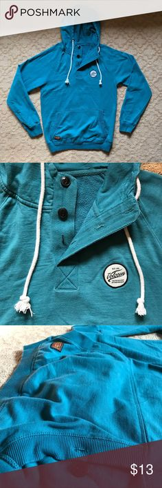 ac76fd304a3 Teal Volcom hoodie Teal Volcom hoodie with button up collar Front pouch  also buttons closed on