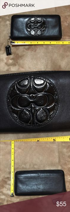 Coach wallet Coach black leather w circle design in patten leather, zip close, one slip pocket on the outside and lots of space inside for everything else you would ever carry,  it has 16 card spaces, please see photos, this is in  great condition only has a few small scuffs on outside, Coach Bags Wallets