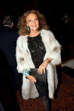 Diane Von Furstenberg forever fashion-forward... Embellishment, fur jacket, clutch & matching turquoise jewels- Perfect party ensemble