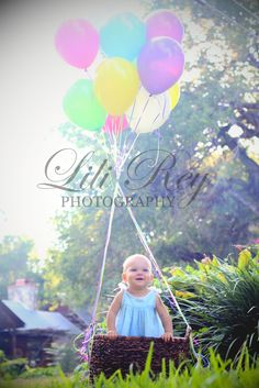 Hot air balloon look with balloons and basket.  Love this idea that one of my clients had! www.lilireyphotography.com: First Birthday Photo Shoot {Katy, TX Family Photographer}