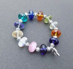 Check out this item in my Etsy shop https://www.etsy.com/listing/466189284/beaded-bracelet-14-mm-rondelle-beads