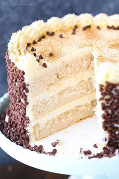 Cannoli Layer Cake - moist and fluffy layers of cinnamon cake with mascarpone and ricotta filling and a mascarpone frosting! To die for!