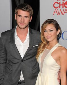Miley Cyrus and Liam Hemsworth. You may not like her but I think they are adorable together <3