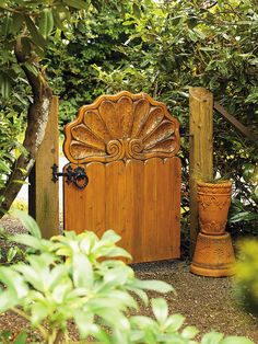 Banas  Carved out of yellow cedar, the intricate pattern on this front gate (which faces into the yard so it can be admired from the porch and garden) was inspired by a bench at a Mexican resort. The handsome wrought-iron latch complements the solidity of the design.
