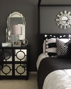 Bedside inspiration from Home Goods! Mirrors, lamp, decorative box and pillows all add touches of glam to this sophisticated bedroom! {Sponsored}