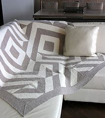 49 identical bi-color moss stitch blocks sewn together with a border to make this modern, cool throw. *Swoon*