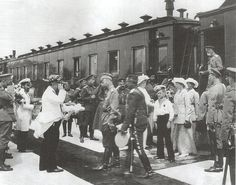 Being greeted as they come off the Imperial train
