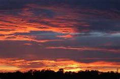 I love Sunsets!  I think that they are breathtaking and are the artwork of GOD himself!  I like to take pictures of them!