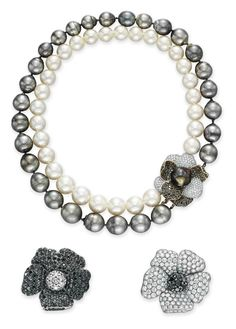 A GROUP OF CULTURED PEARL AND DIAMOND JEWELRY  Comprising a necklace, designed as two strands of gray and white cultured pearls, joined by a circular-cut diamond and black diamond flower blossom clasp; and two brooches, each designed as either a circular-cut diamond or black diamond flower blossom with a contrasting pistil, mounted in white gold, necklace 15¾ ins., brooches may be worn as pendants (pin stems are detachable) Brooches signed de Grisogono