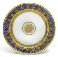 russian porcelain plate . imperial porcelain factory . 1902 . period of nicholas ii . in the style of the ropsha service, with a border of gilt stylised palmettes on a blue ground