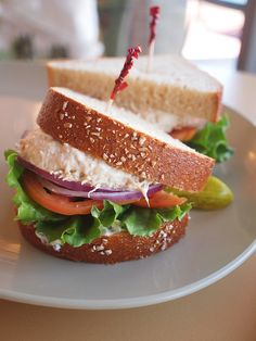 panera's tuna sandwich on wheat.  what i'd like to be having for lunch (minus the onions and tomatoes), along with some cream of chicken and wild rice soup.