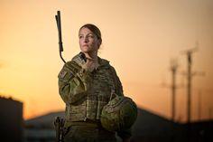 Australian Army communications system operator Signaller listens to her radio handset at the Taji Military Complex Iraq. [2048x1365]