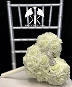 Mickey Bridal Bouquet, Mickey Bridesmaid Bouquet or Flower Girl Bouquet with Ribbon wrapped handle and RHINESTONE PEARL BOW. Made of PREMIUM Real Touch soft roses. Dimensions: Head 10 width X 8.5 height (7 face