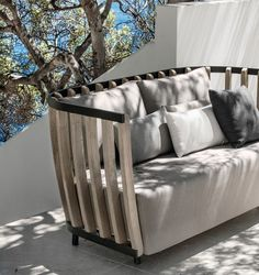 Two seater sofa in pickled teak and black aluminium. Ethimo - Swing