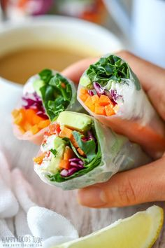 These Vegetarian Fresh Spring Rolls with Peanut Butter Dipping Sauce are packed with fresh vegetables! Salty Feta cheese complements the raw vegetables and gives these rice paper rolls a great flavor! They are light, refreshing and tasty! Homemade Spring Rolls, Fresh Spring Rolls, Homemade Sushi, Raw Food Recipes, Vegetable Recipes, Asian Recipes, Vegetarian Recipes, Healthy Recipes, Rice Wraps