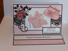 (Ref:J7) 27cm x 17cm easel card. Stamps by Chloe for shoes, purse & sentiment. Dies used, Sue Wilson 'Italian border', Doohickey 'Flourish', La La Land 'Berry Flourish', Dienamics 'Rolled Daisy', Marianne 'Rolled Roses'. Background papers, Nitwit download 'Fine Linen'. Chocolate card from local craft shop, gems from internet search & florist pins from local store. Shoes & purse coloured with Promarkers Baby Pink & Cocktail pink.