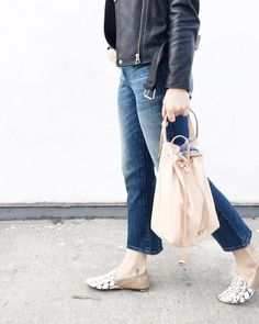leather bucket bag + biker jacket with cropped jeans