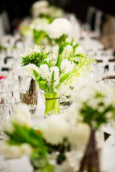 Fresh-looking white and green centerpiece flowers, photos by Studio Impressions | via junebugweddings.com