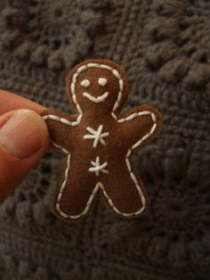 tiny gingerbread --- love it.    Decorating the kitchen with gingerbread men and red and white candies!
