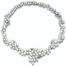 DIAMOND NECKLACE, WOLFERS.    Set with brilliant-cut diamonds highlighted with an undulating scroll of baguette diamonds