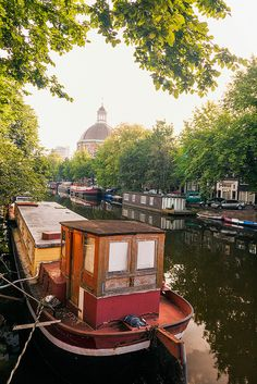 Old river boat, Amsterdam Inner Canal, the Netherlands ~ UNESCO World Heritage Site.  Photo: John and Tina Reid