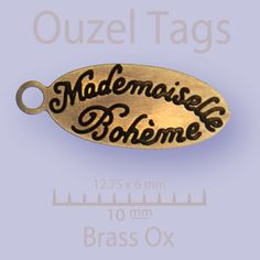 Half Inch x one quarter inch oval metal tag with engraved by ouzel, $77.00