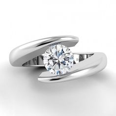 Looking for a really unique engagement ring? Then you cannot miss this contemporary Voltaggio Single Shank Tension Ring by Danhov. Using compression to hold the center piece in place, the diamond appears to be suspended in the air. Is it too simple to astonish or too pretty to be true? www.diamonds.pro