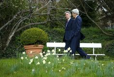 U.S. Secretary of State John Kerry talks to British Foreign Secretary Philip Hammond in the Olympic Garden next to the Beau Rivage Palace Hotel in a break during Iran nuclear program talks in Lausanne, Switzerland, March 30, 2015. REUTERS/Ruben Sprich