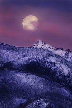 Moonset on Bitterroots by Derek Poff