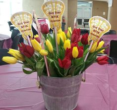 "Lacrosse centerpiece from Senior Night dinner.  Fresh tulips in a tin with pixie stix.  Image seach girls lacrosse heads and fine one that is the correct color for your team.  Import into a word document and then create a text box with text ""Our team STIX together"" Move text box over image until centered.  Copy and paste to fit 4 images per page.  I sent to Staples print center and had done on card stock. Cut out lacrosse heads and use a large crafting punch to put a hole in bottom.  Attach…"