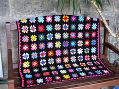 Check out this item in my Etsy shop https://www.etsy.com/uk/listing/77535246/retro-granny-square-blanket-crochet