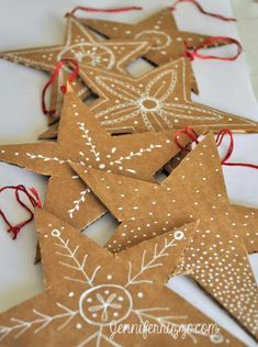 recycled cardboard made into stars. Cardboard and white gel pens. I can't help myself - I find tags intriguing. Always have. Maybe they hearken back to child-magic.