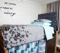 An easy way to personalize and add a pop of color to your dorm room is by hanging up a custom made headboard using Command™ Picture Hanging Strips! #Greatdormhookup #collegelife