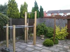 Outside beside porch.  Make both sections tall to hang muscle up rings off of