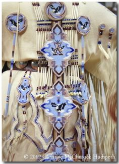 some random  person pinned monicas bead work! i saw it and was like ummmm MONICA! its beautiful! and you cant even see the cute little bows or the beautiful crown! so sad! :) Gorgeous Bead and Leather Work