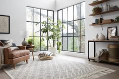 Shop Magnolia Home rugs by Joanna Gaines at Shades of Light! These area rugs bring the simple, timeless style of HGTV's Fixer Upper co-star into your home!