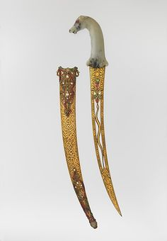Dagger with Sheath Date: Hilt, 17th–18th century; blade and sheath, 19th century Culture: Hilt, Indian, Mughal; blade and sheath, Turkish, Ottoman Medium: Steel, nephrite, gold, emerald, ruby, diamond, sapphire, jade