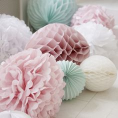 Paper Pom Poms  Liv is the master at making these (like the one's for her 21st) I think baby pink and whites are colours to stick with - that way we can keep the theme going throughout all the wedding stuff.