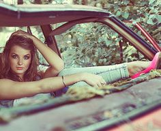 The new grunge- old car, unconventional life, but good clothes! Look at those heels!