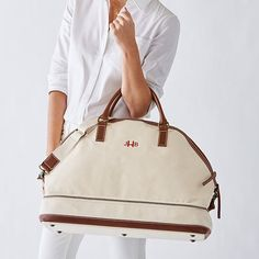 Pack your bags and get ready for a weekend away with this essential cotton canvas weekender. This spacious carryall features warm leather accents, a striped cotton lining, an inside zippered pocket and an adjustable shoulder strap. Resort Wear For Women, Pack Your Bags, Boho Bags, Jet Plane, Product Ideas, Style And Grace, Canvas Leather, You Bag, Leather Handle