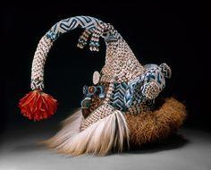 Kuba Mask (Mukenga), Late 19th/mid-20th century  Wood, glass beads, cowrie shells, feathers, raffia, fur, fabric, thread, and bells  57.5 x 24.1 x 20.3 cm (22 5/8 x 9 1/2 x 8 in.)  Laura T. Magnuson Fund, 1982.1504