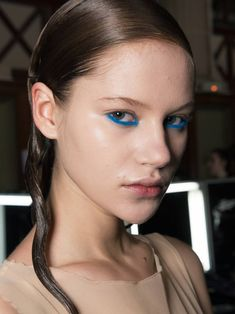 Neon blue eyeliner. We'll Never Get Bored of Looking at Couture Beauty Looks | Byrdie UK