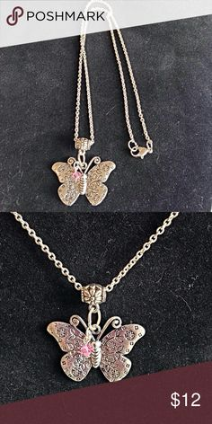 Handcrafted Silver-Plated Butterfly Necklace This cute necklace is a silver plated butterfly charm necklace. The chain is silver-plated which measures a little over 14-inches. In addition to the butterfly charm, a pink Swarovski pink bicone bead charm is added.  If you need a smaller or larger necklace, please comment on this listing of your desired length.  This necklace is made from a smoke-free home.  ~Thanks For Looking!~ Jewelry Necklaces