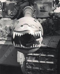Shark bite! One of the Tiger Tank of the schwere Panzer-Abteilung 502 is painted with tiger shark's teeth on the muzzle brake, summer 1943.