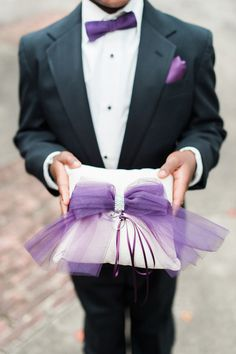 Purple ring bearer idea - black tux with purple bow tie and white pillow + purple bow {MyLife Photography}