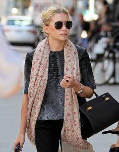 Ashley Olsen in aviators, a print scarf, fur top & bag from The Row #style #fashion #mka #olsentwins