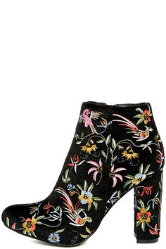 "Striking colors and intricate embroidery make the Quetzal Black Velvet Embroidered Ankle Booties a must-have! Ultra soft velvet, embellished with colorful floral embroidery, forms a rounded toe upper and ankle-high shaft with 5"" zipper at the instep."