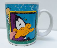 A personal favorite from my Etsy shop https://www.etsy.com/listing/476741545/vintage-daffy-duck-warner-brother-mug