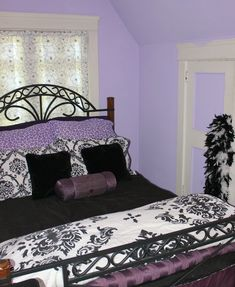 Here's my daughter's purple n black Teen Bedroom done on a budget at www.Concordcottage.com